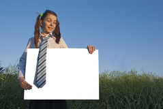Teen girl holding white poster Stock Photo