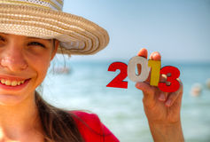 Teen girl holding wooden number '2013' Stock Photography
