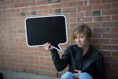 Teen girl holds black sign Stock Images