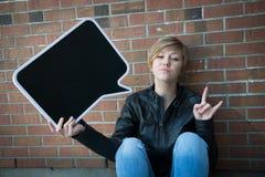 Teen girl holds black sign Stock Photo