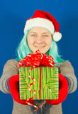 Teen girl holds Christmas present Stock Photo