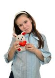 Teen girl holds favorite toy hare Royalty Free Stock Images