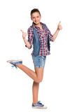 Teen girl holds her thumbs up Royalty Free Stock Photo