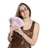 Teen girl holds money in a fan-shape Stock Image