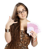 Teen girl holds money in a fan-shape Stock Photography