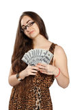 Teen girl holds money in a fan-shape. Long-haired teenager girl in leopard dress holds dollars in hand in a fan-shape, isolated on white background Royalty Free Stock Photography
