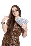 Teen girl holds money in a fan-shape Royalty Free Stock Image