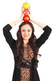Teen girl holds an three apples on her head Stock Images