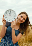 Teen girl holds watches Stock Photo