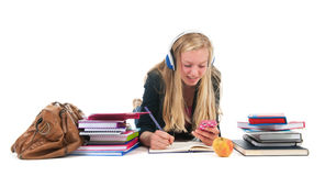 Teen girl with homework and smarphone Royalty Free Stock Photography