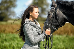 Teen girl with the horse. Beautiful young teen girl with the brown horse Royalty Free Stock Photo