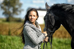 Teen girl with the horse Stock Image