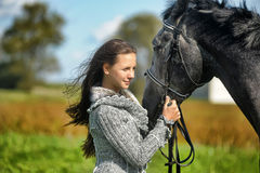 Teen girl with the horse Stock Photo