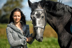 Teen girl with the horse Stock Photography