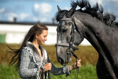 Teen girl with the horse Royalty Free Stock Images