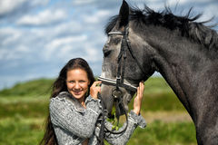 Teen girl with the horse Royalty Free Stock Photo