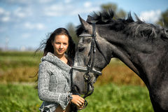Teen girl with the horse Royalty Free Stock Image