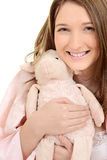 Teen girl hugging toy lamb Stock Image