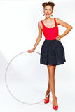 Teen girl with hula hoop Royalty Free Stock Images
