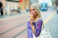 Teen girl with ice cream Stock Images