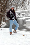 Teen girl with ice skates in snow. Ice skater teen girl in snow by frozen river with hockey ice skates Stock Photos