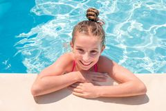 Free Teen Girl In Swimming Pool Squinting Her Eyes Royalty Free Stock Photos - 125323268