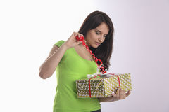 Teen girl interested with gift Royalty Free Stock Photography