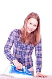 Teen girl ironing clothes Royalty Free Stock Images