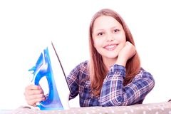 Teen girl ironing clothes Stock Image