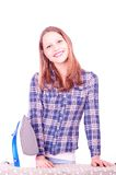 Teen girl ironing clothes Stock Photography