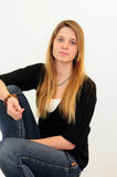 Teen girl jeans. Attractive red head girl on white background in jeans and black shirt stock photos