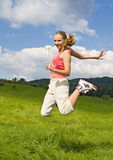 Teen girl jump on meadow Royalty Free Stock Photos