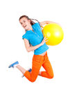 Teen girl jumping with ball Royalty Free Stock Image