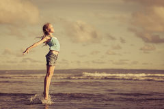 Teen girl  jumping on the beach at blue sea shore in summer vaca Royalty Free Stock Photography
