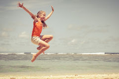 Teen girl  jumping on the beach Royalty Free Stock Photo