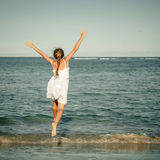 Teen girl jumping on the beach Royalty Free Stock Images