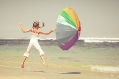 Teen girl  jumping on the beach Royalty Free Stock Image