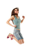 Teen girl jumping cheerful Royalty Free Stock Image