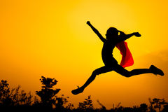 Teen girl jumping on the nature. Teen girl in superhero costume jumping in the evening on the nature Royalty Free Stock Photos