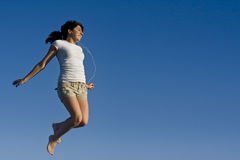 Teen girl jumping in the sky Stock Photo