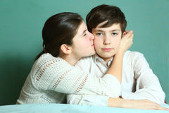 Teen girl kiss brother close up portrait Stock Image
