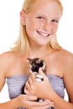 Teen girl kitten. Cute freckled teen girl holding a little kitten isolated on white Royalty Free Stock Image