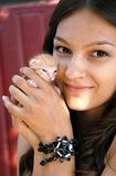 Teen girl with a kitty Royalty Free Stock Photography