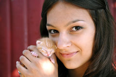 Teen girl with a kitty Stock Photos