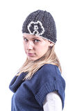 Teen girl with knit hat and cardigan. Teen geril with knit hat and blue cardigan Royalty Free Stock Photography