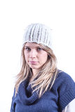 Teen girl with knit hat and cardigan. Teen geril with knit hat and blue cardigan Royalty Free Stock Photos