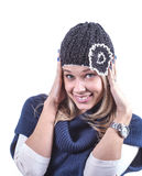 Teen girl with knit hat and cardigan. Teen geril with knit hat and blue cardigan Stock Image