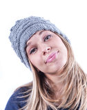 Teen girl with knit hat and cardigan. Teen geril with knit hat and blue cardigan Royalty Free Stock Image
