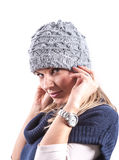 Teen girl with knit hat and cardigan. Teen geril with knit hat and blue cardigan Royalty Free Stock Images