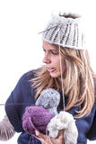 Teen girl with knit hat and cardigan. Teen geril with knit hat and blue cardigan Stock Photos